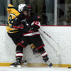 Marblehead sophomore forward Colin Daly (26) throws an elbow into North Reading sophomore forward Patrick Driscoll (24), separating him from the puck during the second period of play on Friday evening in the D2 North Quarter Finals at Stoneham Arena in Stoneham. DAVID LE/Staff Photo 2/28/14