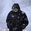 Adam Rowe, of Salem, braves the heavy snow as he treks down Rantoul St. in Beverly on Thursday afternoon. DAVID LE/Staff photo