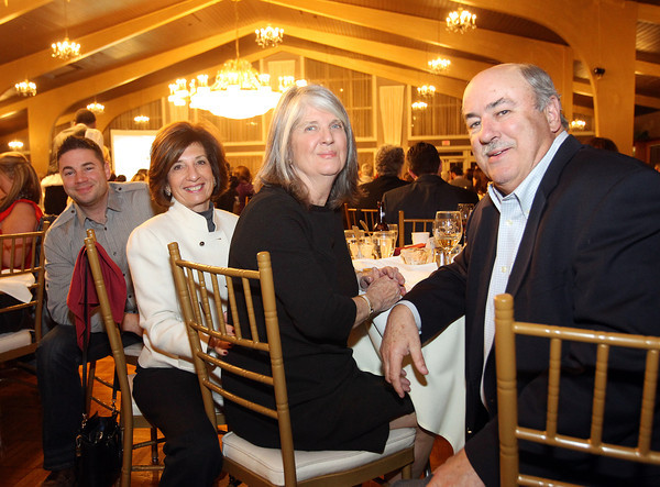 From left, Jesse Jalbert, Fran Temkin, and Richard and Diane Jones, at the Third Annual Business Awards hosted by the Greater Beverly Chamber of Commerce at the Danversport Yacht Club on Thursday evening. DAVID LE/Staff Photo 2/27/14