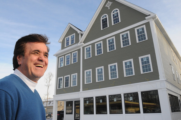 Ken Yuszkus/Staff photo: Danvers:  Peter Pantezelos stands near the new mixed use commercial and residential building at 78 Holton Street in Danvers.