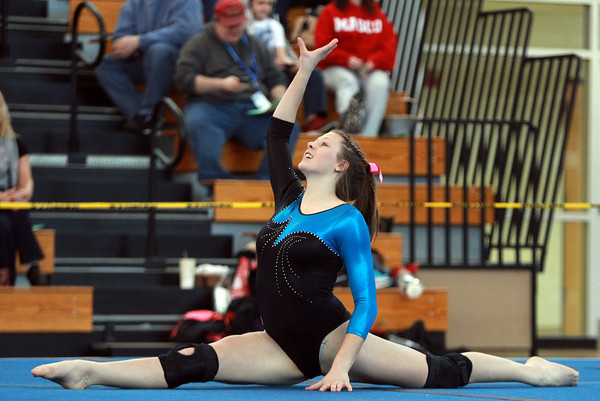 Danvers gymnast Julia Valenti performs her floor routine during the North Sectional Tournament held at Hudson High School on Saturday. DAVID LE/Staff Photo 2/21/14