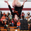 Beverly gymnast Kara MacGilvray flips head over heels during the North Sectional Tournament held at Hudson High School on Saturday. DAVID LE/Staff Photo 2/21/14