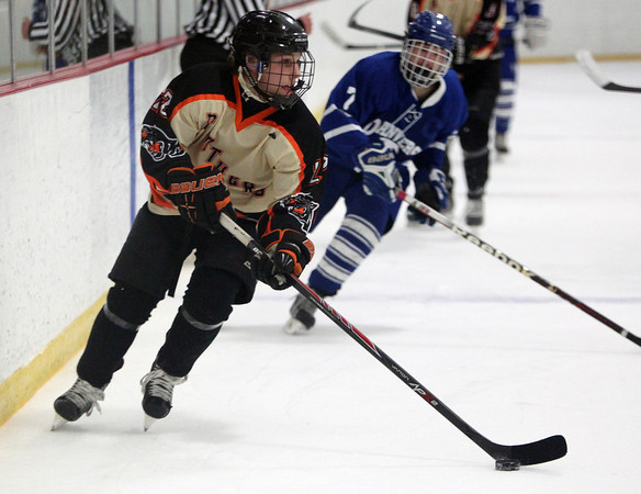 Beverly senior captain Connor Irving (22) carries the puck against Danvers on Friday evening during the D2 North Quarterfinals at Stoneham Arena in Stoneham. DAVID LE/Staff Photo 2/28/14