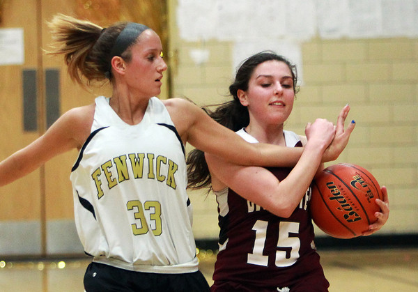 Gloucester senior captain Julianna Costanzo (15) wrestles a loose ball away from Bishop Fenwick senior captain Kate Lipka (33) during the first half of play on Thursday evening. DAVID LE/Staff photo
