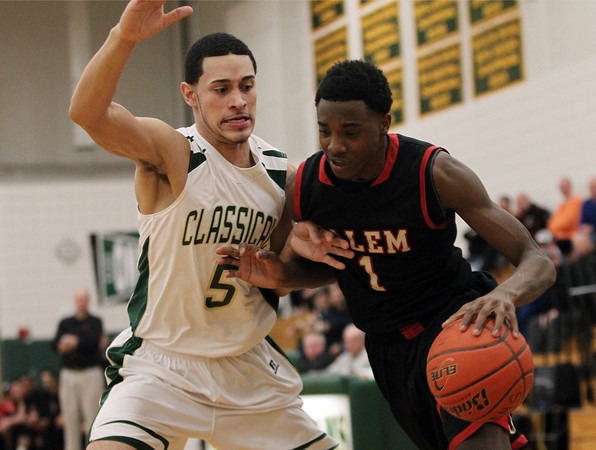 Salem senior forward Rashad Keys (1) tries to muscle his way past Lynn Classical senior Eddie Solis (5) during the first half of play on Friday evening. DAVID LE/Staff Photo 2/14/14