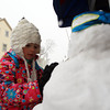 Four-year-old Clara Quigley, of Marblehead, works on her snowman she made on the bench in front of Mud Puddle Toys in Old Town on Wednesday afternoon. DAVID LE/Staff photo. 2/5/14
