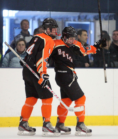 Beverly junior forward Clinton Cabral (19) celebrates his third period goal with junior teammate Ted Leathersich (4) on Monday afternoon against Peabody in the 27th Annual Carlin Cup. DAVID LE/Staff Photo 2/17/14