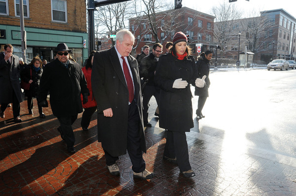 Ken Yuszkus/Staff photo:  Federal Reserve Bank president Eric Rosengren walks across Lafayette Street in Salem with Salem Mayor Kim Driscoll as they lead the walking tour of the Point neighborhood Tuesday morning.