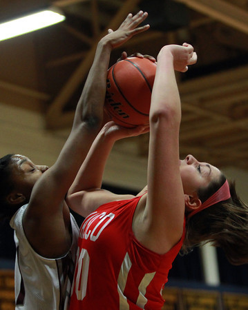 Masco freshman forward Stephanie Mini (30) gets fouled by Lynn English senior Diondra Woumn (1) as she drives to the hoop during the St. Mary's Spartan Classic on Monday evening at St. Mary's High School in Lynn. DAVID LE/Staff Photo 2/17/14