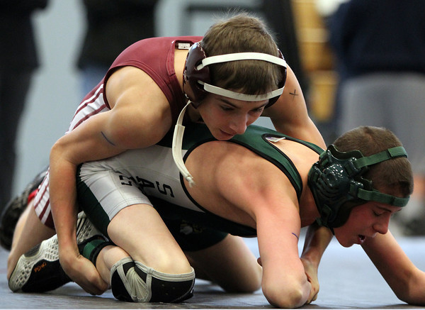 Gloucester's Colin Harrison ties up with Pentucket's Sam Marchant during the D3 North Wrestling State Meet at Danvers High School on Saturday morning. DAVID LE/Staff photo
