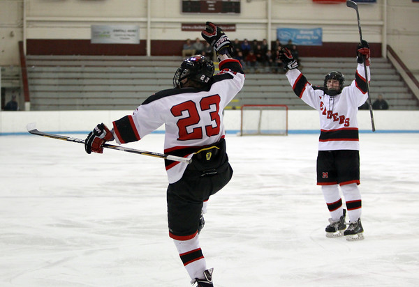 Marblehead freshman forward Braden Haley (23) celebrates his second period goal against Haverhill on Tuesday evening. DAVID LE/Staff photo 2/25/14