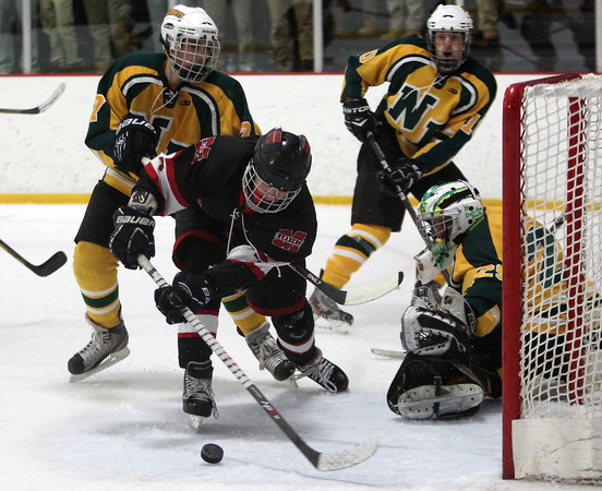 Marblehead sophomore centerman Matt Koopman (7) tries to bury the puck with a wide open net mouth past North Reading senior goalie Keith Linnane (29) during the third period of play on Friday evening in the D2 North Quarter Finals at Stoneham Arena in Stoneham. DAVID LE/Staff Photo 2/28/14