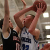 Danvers junior center Peter Merry goes up strong to the hoop while being defended by a Marblehead player on Wednesday evening. DAVID LE/Staff Photo 2/26/14