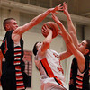 North Andover junior Brett Daley (11) and senior James Testa (35) combine for a block on Beverly senior guard Chris Sinclair (5) as he drives to the hoop during the first half of play on Tuesday evening. DAVID LE/Staff photo 2/25/14