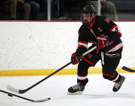 Marblehead senior captain Liam Gillis (9) pushes the puck up ice against North Reading on Friday evening during the D2 North Quarter Finals at Stoneham Arena in Stoneham.  DAVID LE/Staff Photo 2/28/14