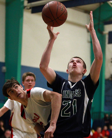 Pingree sophomore Griffin Beal (21) grabs a rebound away from PCD's Nick DeBlasio (2) during the first half of play on Wednesday evening. DAVID LE/Staff Photo 2/26/14