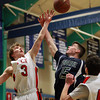 Pingree senior captain Connor Reardon (15) battles for a rebound with Providence Country Day's Tom Horvat (3) during the second half of play on Wednesday evening. DAVID LE/Staff Photo 2/26/14