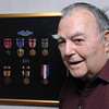 Ken Yuszkus/Staff photo: Danvers:  World War II veteran, former Danvers veterans agent Perley Roderick Jr. is being honored by the American Legion Post 180 with its fifth annual Americanism Award. He is standing in front of a display of his medals.