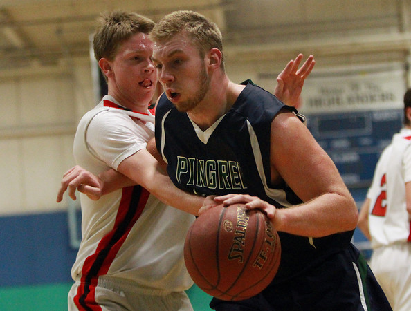 Pingree senior captain Kyle Lentini (22) drives strong to the hoop past Providence Country Day's Harrison Igoe, left, during the first half of play on Wednesday evening. DAVID LE/Staff Photo 2/26/14