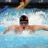 Marblehead's Thomas Rockett launches himself forward and out of the water during the butterfly leg of the 200 Medley Relay, which the Magicians won. DAVID LE/Staff photo