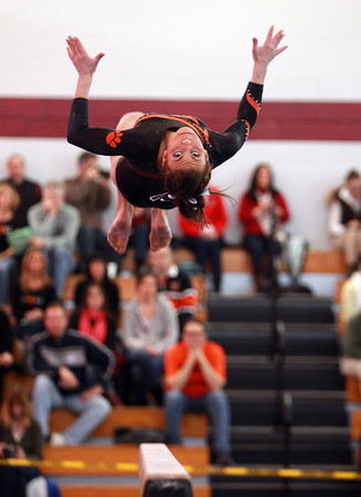 Beverly gymnast Heather Gomes soars in midair while doing a backflip on her beam routine during the North Sectional Tournament held at Hudson High School on Saturday. DAVID LE/Staff Photo 2/21/14