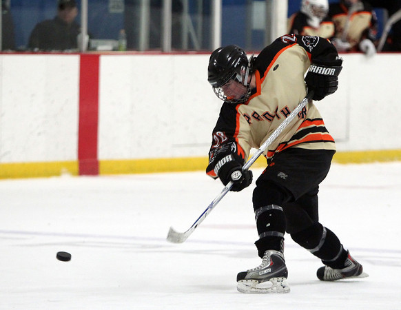 Beverly junior defenseman Caitlin McBride (20) fires a slap shot from the point during a Panthers power play during the second period of play on Wednesday evening. DAVID LE/Staff photo 3/5/14