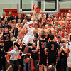 Beverly senior Nick Cross tries to dunk the ball on a breakaway against North Andover as anxious Beverly fans  wait to see the result of the play. DAVID LE/Staff photo 2/25/14