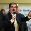 Rene Rancourt, a local icon who sings the National Anthem for the Boston Bruins, belts out the National Anthem at the start of the Bishop Fenwick and Gloucester girls basketball game at Bishop Fenwick High School on Thursday evening. DAVID LE/Staff photo