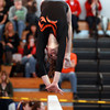Beverly gymnast Kara MacGilvray concentrates on the beam while doing a backflip during the North Sectional Tournament held at Hudson High School on Saturday. DAVID LE/Staff Photo 2/21/14