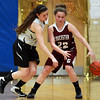 Gloucester guard Kayla Nasser (22) shields the ball from Bishop Fenwick senior captain Gianna Pizzano (23) on Thursday evening. DAVID LE/Staff photo