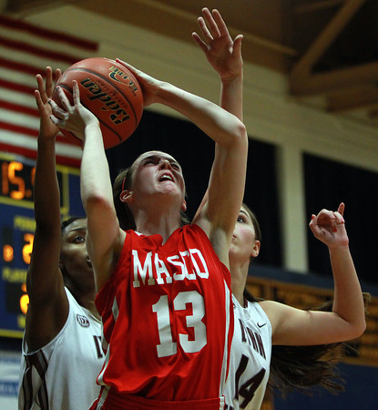Masco junior Kate Kitsakos (13) gets fouled by Lynn English seniors Makayla Everette (5) and Brianna Goulet (14) during the first half of play during the St. Mary's Spartan Classic on Monday evening at St. Mary's High School in Lynn. DAVID LE/Staff Photo 2/17/14