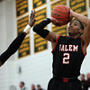 Salem senior guard Shaky White (2) drains a three-pointer against Lynn Classical on Friday evening. DAVID LE/Staff Photo 2/14/14