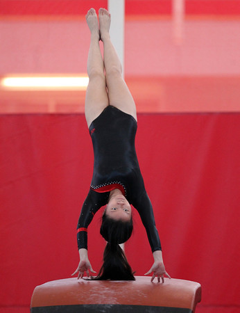 Masco gymnast Stephanie Li launches herself off the vault during the North Sectional Tournament held at Hudson High School on Saturday. DAVID LE/Staff Photo 2/22/14