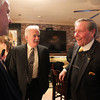 Retired Peabody Police Chief Robert Champagne, right, talks with Chief Dan O'Leary, left, of the Brookline Police Department, and Chief Kevin Coppinger, of the Lynn Police Department at his retirement party held at Timothy's on Route 1 in Danvers on Wednesday afternoon. DAVID LE/Staff photo
