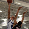 Danvers junior forward Devan Harris (25) takes a hook shot over Marblehead junior Angel Perez (20) during the first half of play on Wednesday evening. DAVID LE/Staff Photo 2/26/14