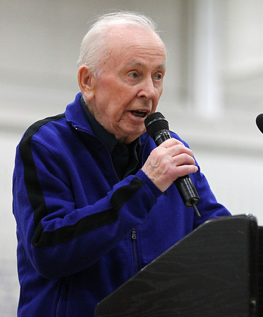 """Legendary Swampscott High School coach and athletic director Dick Lynch speaks during the dedication of the Richard """"Dick"""" Lynch Gymnasium ceremony at Swampscott High School on Tuesday evening. DAVID LE/Staff photo"""