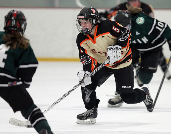Beverly sophomore forward Kristen McCarthy (5) flies up ice while carrying the puck against Austin Prep in the D1 State quarterfinal on Wednesdy evening. DAVID LE/Staff photo 3/5/14