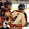 Beverly sophomore Anna O'Neill (9) comes over to congratulate senior captain Nicole Woods (4) on her second period goal against Chelmsford. DAVID LE/Staff Photo 2/19/14