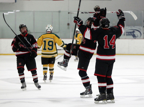 Marblehead senior forward Erik Powers (19), center, celebrates his empty net goal with less than a minute remaining with teammates Kyle Koopman (14) and Dean Fader (17) to ice the Headers win over North Reading in the D2 North Quarter Finals on Friday evening. DAVID LE/Staff Photo 2/28/14