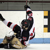Marblehead freshman defenseman Alex DelVento (27) gets upended by sliding Haverhill senior Matt Arena (16) during the first period of play on Tuesday evening. DAVID LE/Staff photo 2/25/14