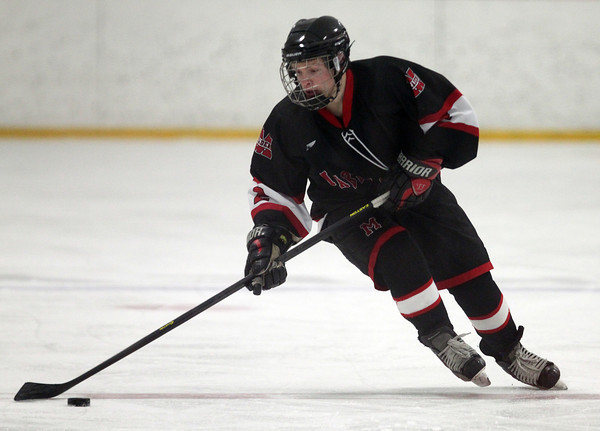 Marblehead senior forward Chris Cormier (2) flies up ice carrying the puck on Friday evening. DAVID LE/Staff Photo 2/28/14
