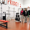 Ken Yuszkus/Staff photo: Salem:  From left, teachers Melissa St. Pierre, Lisa Mansfield, and student Austin Connolly walk through the wellness/workout center at Salem High School. Students are currently working on a project to raise money/collect donations to renovate and equip the wellness workout center at the high school.    2/25/14