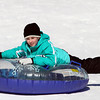 Eleven-year-old Rachel Botte, of Beverly, holds on to her snow tube while sledding down the hill at Lynch Park on Monday afternoon. DAVID LE/Staff photo