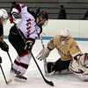 Marblehead senior captain Tom Koopman (5) tries to bury a backhand shot past sprawled Haverhill goalie Mike Cleason (30) on Tuesday evening. DAVID LE/Staff photo 2/25/14