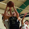 Pingree junior Erik Fryrer (5) grabs an offensive rebound in the middle of a pack of Providence Country Day players on Wednesday evening. DAVID LE/Staff Photo 2/26/14