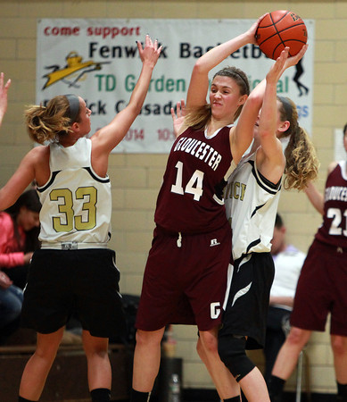 Gloucester's Hannah Ellis (14) looks to make a pass while being defended by Bishop Fenwick senior Kate Lipka (33) and Colleen Corcoran (24) during the first half of play on Thursday evening. DAVID LE/Staff photo