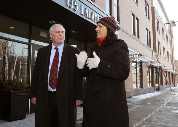 Ken Yuszkus/Staff photo: Salem:  Federal Reserve Bank president Eric Rosengren listens to Salem Mayor Kim Driscoll during a walking tour of the Point neighborhood Tuesday morning. They are in front of the new apartment building at 135 Lafayette Street.