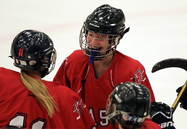 Masco freshman forward Isabelle Sarra (19), center, celebrates her first period break-away goal with her teammates. DAVID LE/Staff Photo 2/6/14
