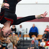 Masco gymnast Amanda Davekos flips upside down during her floor routine during the North Sectional Tournament held at Hudson High School on Saturday. DAVID LE/Staff Photo 2/21/14