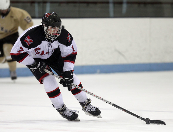 Marblehead sophomore center Matt Koopman (7) carries the puck against Haverhill on Tuesday evening. DAVID LE/Staff photo 2/25/14